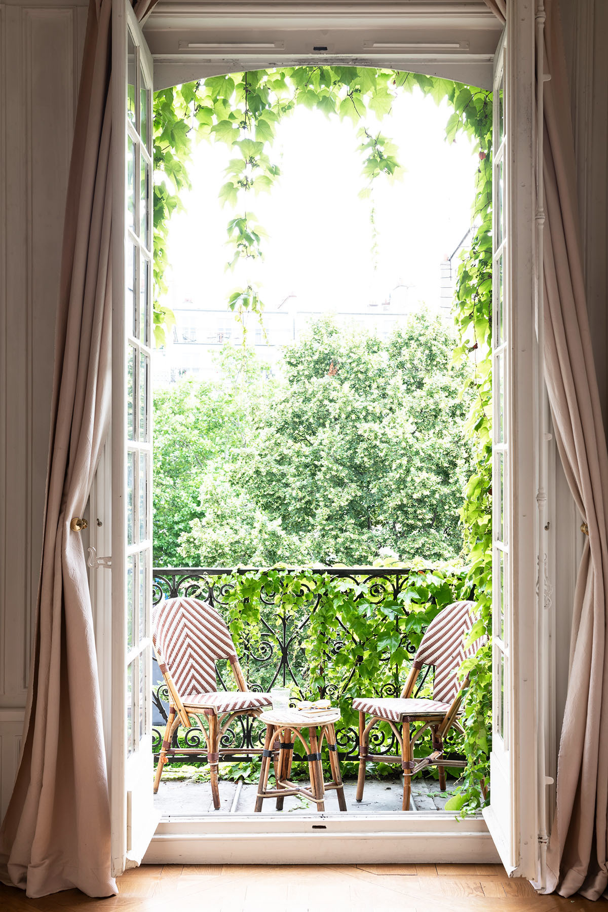"""I found my chairs at Grock Café on Boulevard Beaumarchais,"" Folk explains. ""They supply most hotels, restaurants, and cafes. I purchased them while out with a group of friends and we walked all the way home with them."" Marrakshi Life Custom Drapes."