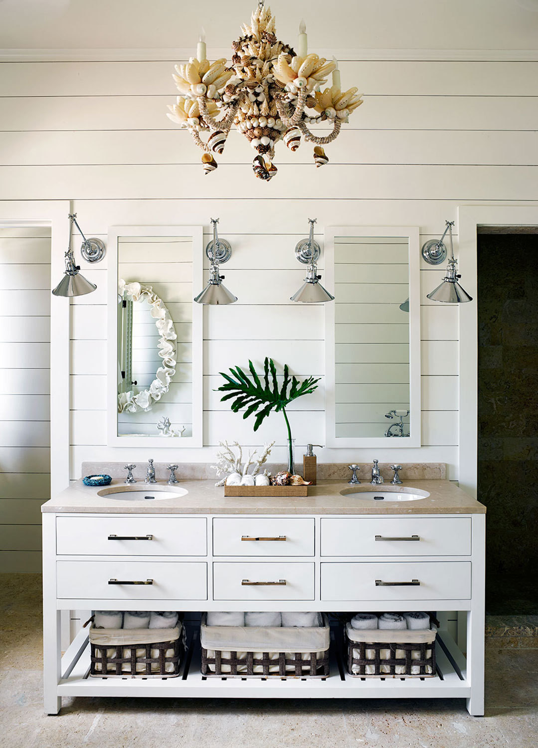 A shell chandelier looks apropos in this otherwise subtle bath.