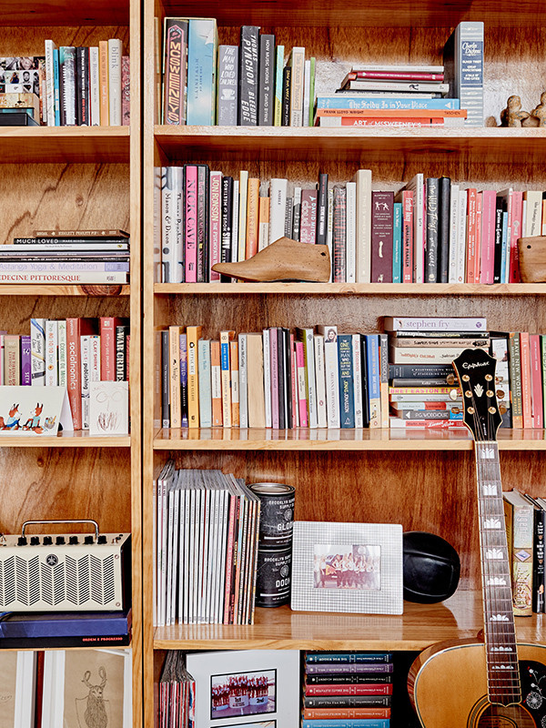 Items collected during the couple's international travels animate a bookcase, which also acts as a room divider.