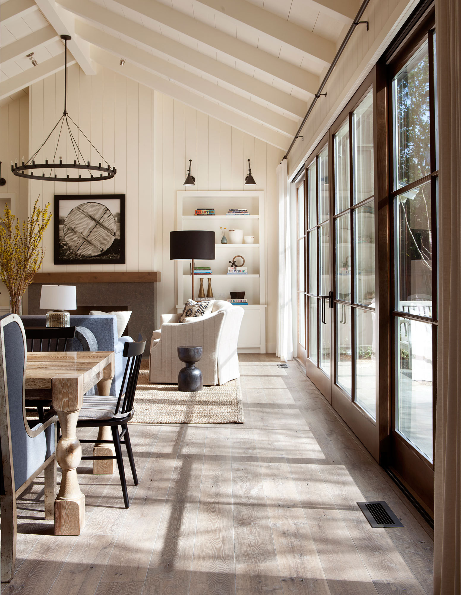 Custom-stained oak hardwood flooring lends rustic ambiance throughout the main living space.