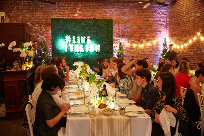 The motto of the moment—hashtag included—was displayed on a wall of greenery.