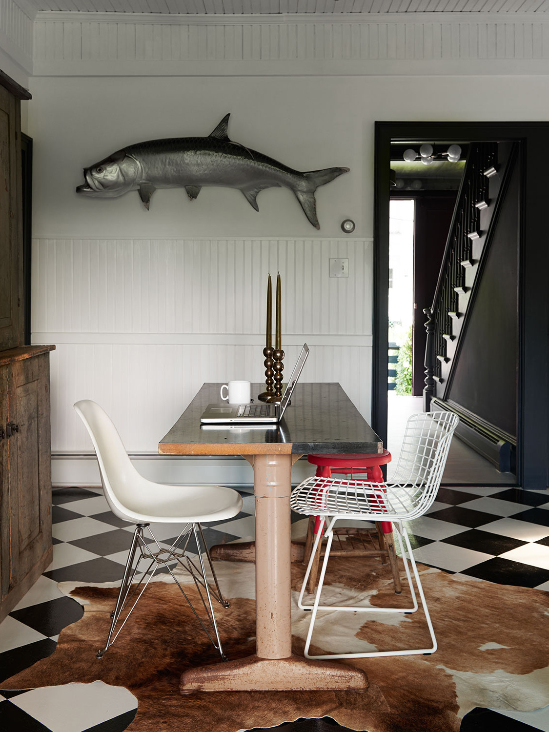 A massive mounted fish watches over a dining area.