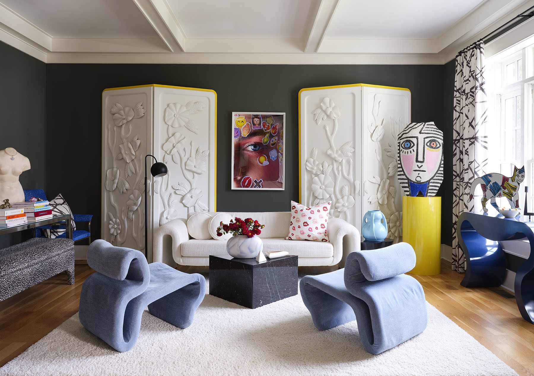 Angela Chrusciaki Blehmreally indulged the senses in her bright and vivid living room.Sherwin-Williams Paint |Steve Leonard for Brayton International Vintage Sofa |Angela Chrusciaki Blehm Custom Pillow |Mimosa Lane Artwork | Vintage Accent Chairs |Gillian Bryce Screen |Gainsville Flooring Custom Rug |Gillian Bryce Artwork.