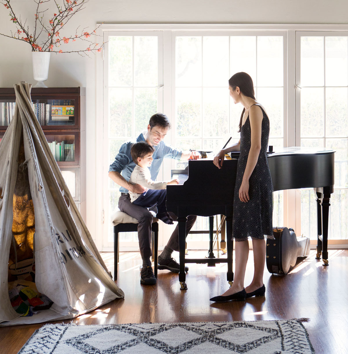 Andrew Bird, Katherine Tsina, and their son, Sam, in their Los Angeles residence.Prop styling by Britt Browne.