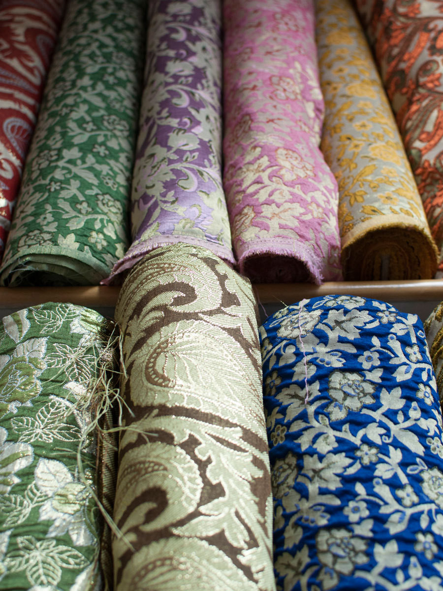A fabric market shows off a rainbow assortment of silk jacquard.
