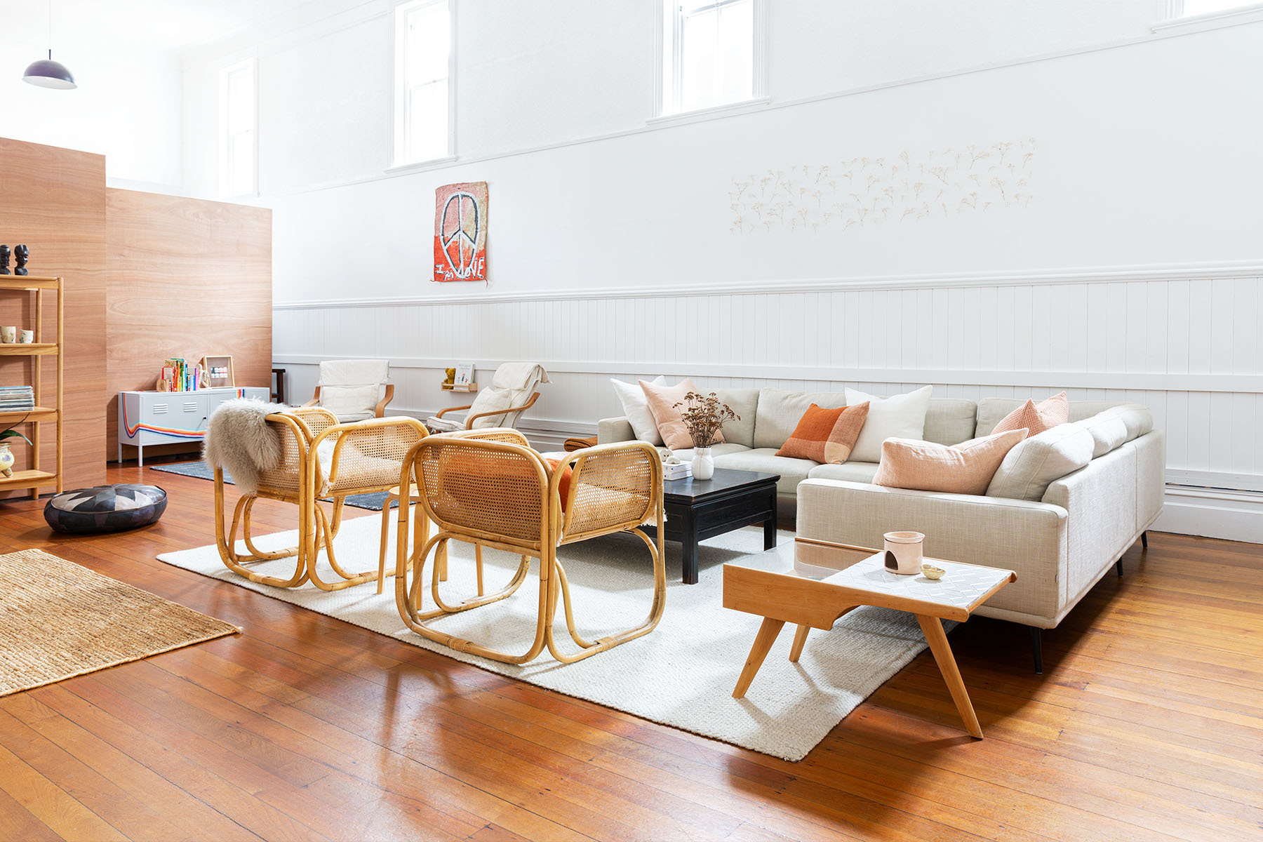 Jessica Britten and fiancé Warren Durling took an old fraternity hall and created a layered family home. BoConcept Sofa | Flooring Xtra Rug | Nodi Jute | McMullin & Co. Armchairs | Città Assorted Pillows | Vintage Turkish Pouf | Vintage Artwork | Bunnings New Zealand Pendant Lights | Flooring Xtra Sheepskin | Nodi Area Rug | Heirloom Armchairs | Heirloom Sculptures | Asili Accent Pieces | Trade Aid, Vintage Toys | Trade Aid Customized Baskets | Vintage Customized Filing Cabinet.