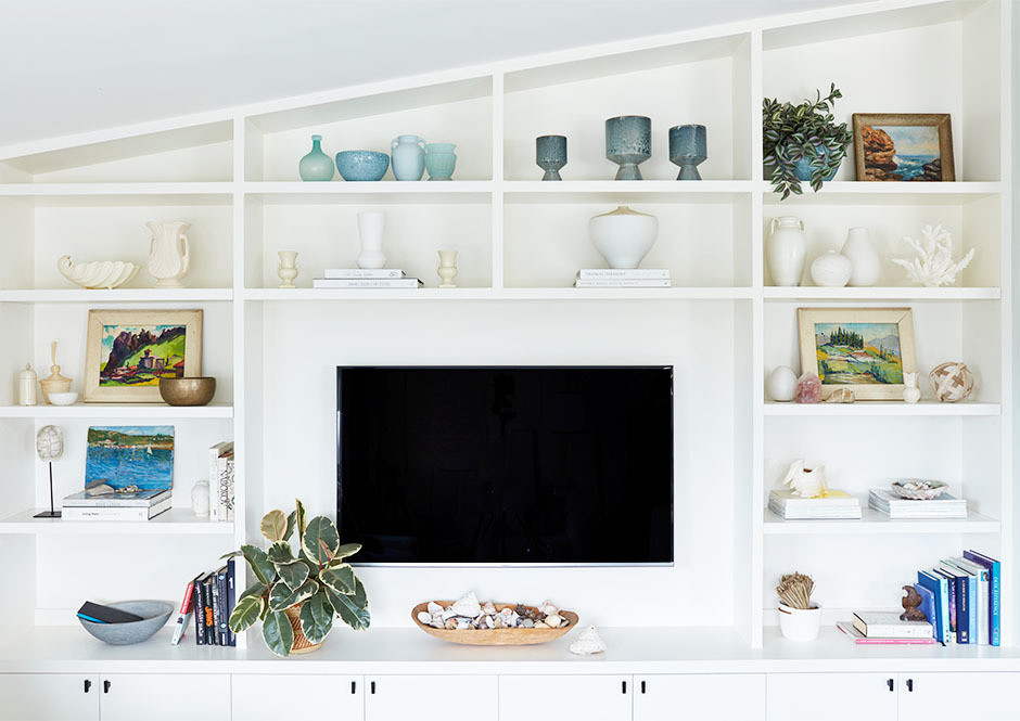 Contemporary open shelving, carefully curated books, and accent pieces, reflect Driver's personal tastes.