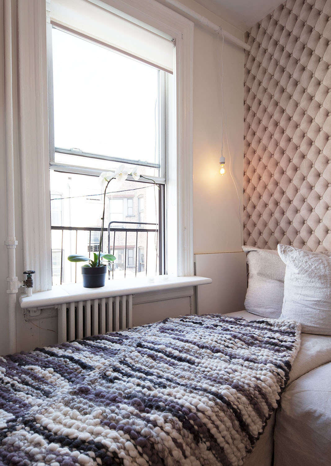 Lampert's hand-knit throw provides warmth by the window.