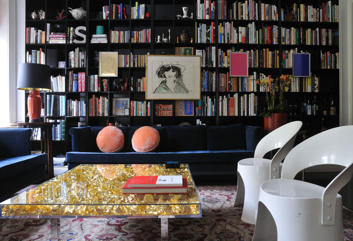 The joy of reading takes center stage in this room, even in the presence of a gold-leaf table by Yves Klein.