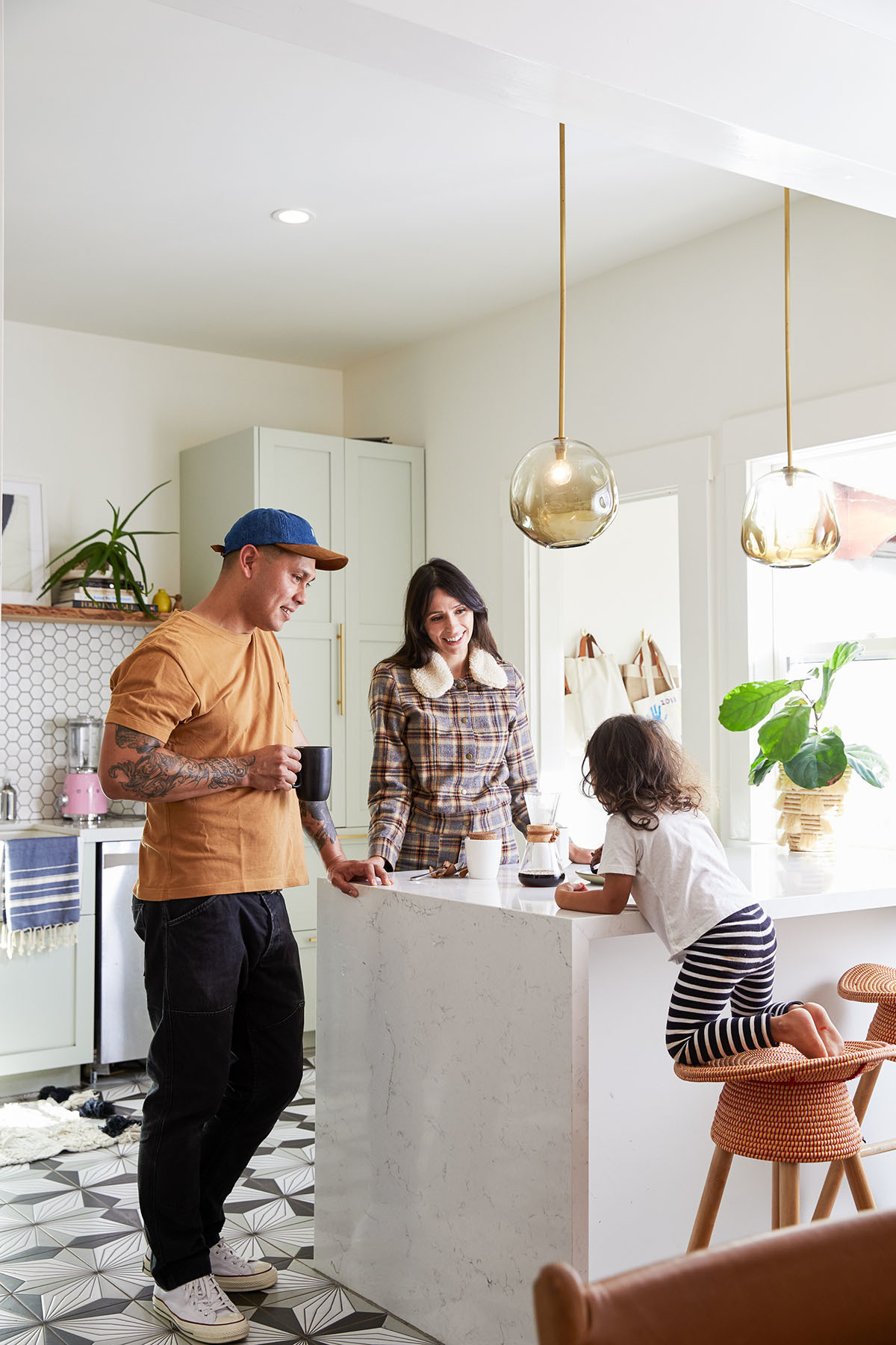 Eric, Angela and Tallie at home in their modern kitchen.