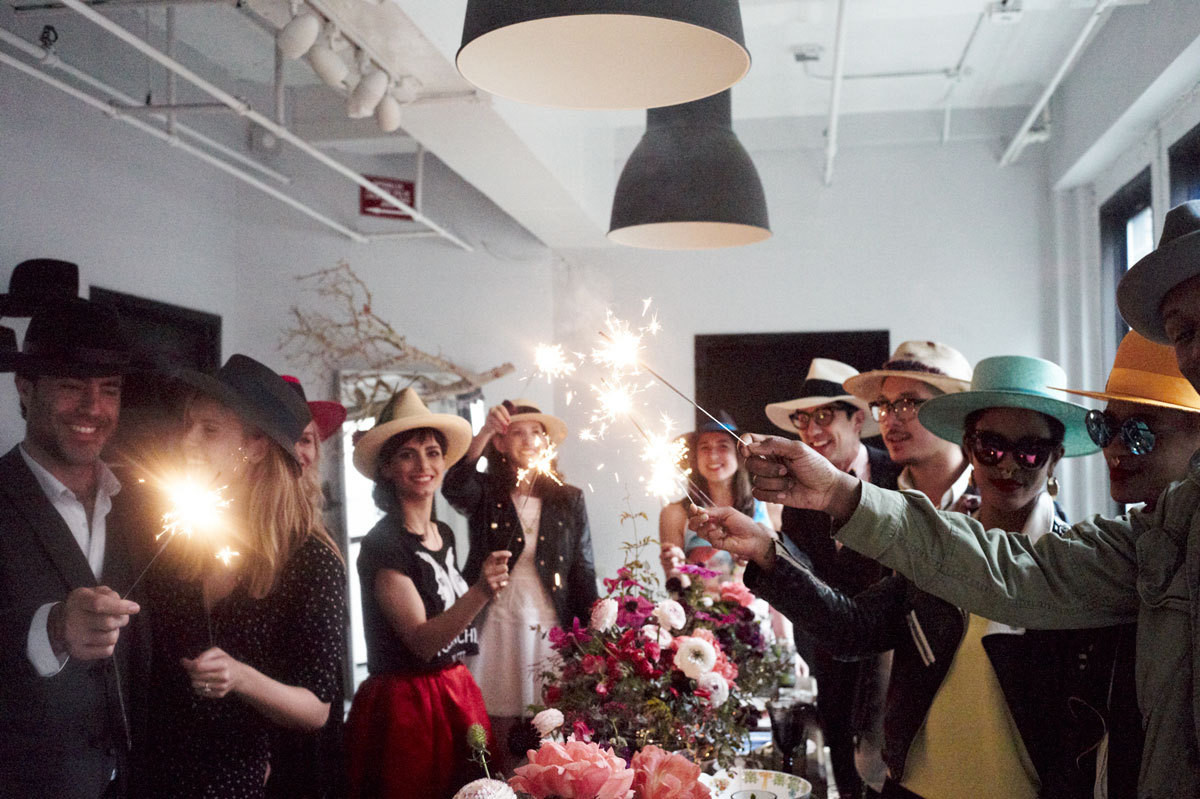 New York City milliner Satya Twena and friends celebrate the Kentucky Derby with a sparkler send-off.
