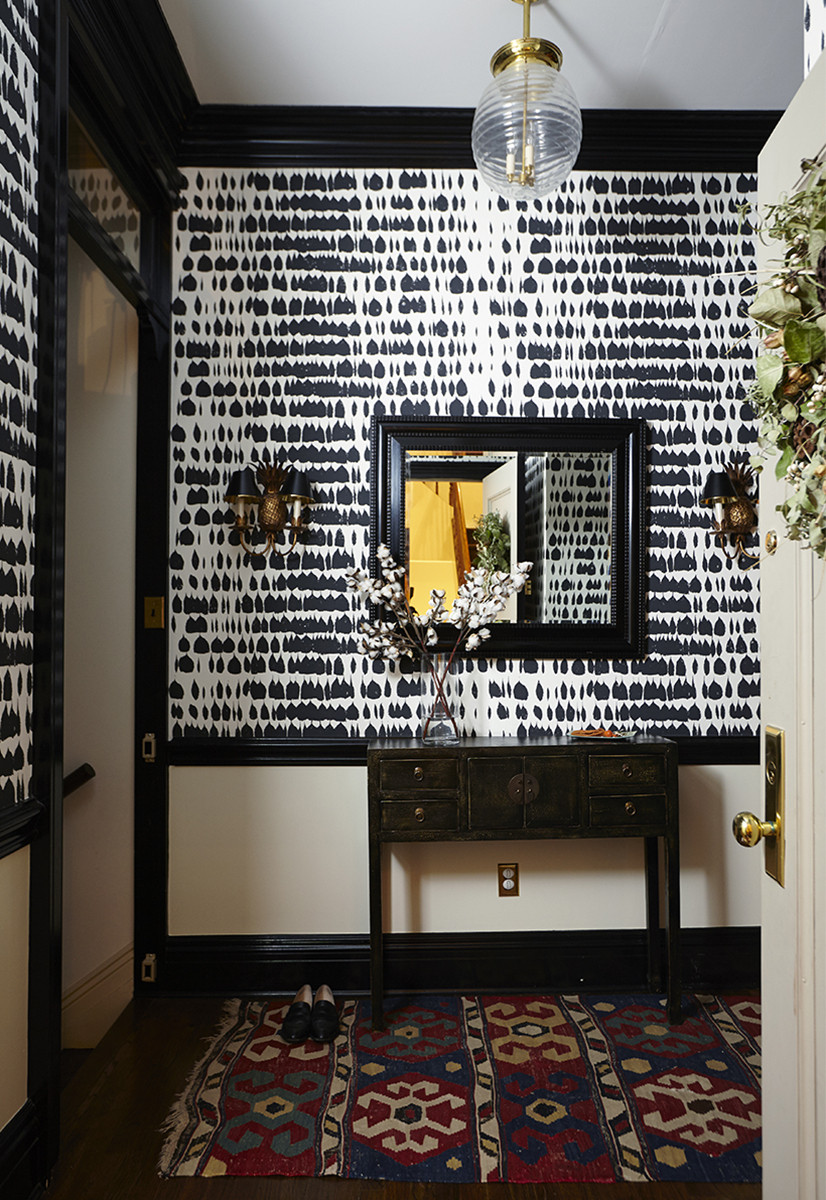 Schumacher's Queen of Spain wallpaper creates a graphic focal point in the apartment's foyer.