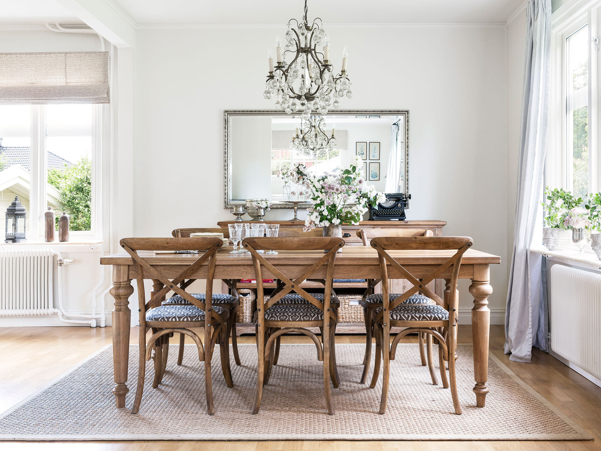 An antique chandelier gifted to Wihlborg by her mother is suspended above the white-oak dining table (from Rachel Ashwell's Shabby Chic Couture).