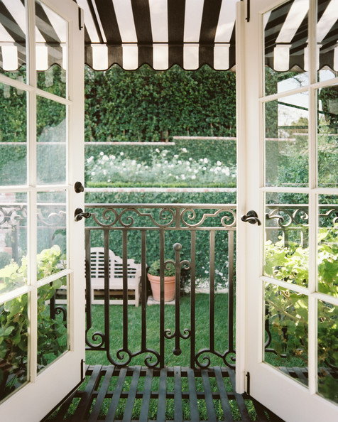 From the master suite, a petite, wrought-iron terrace overlooks the home's Italian-style garden.