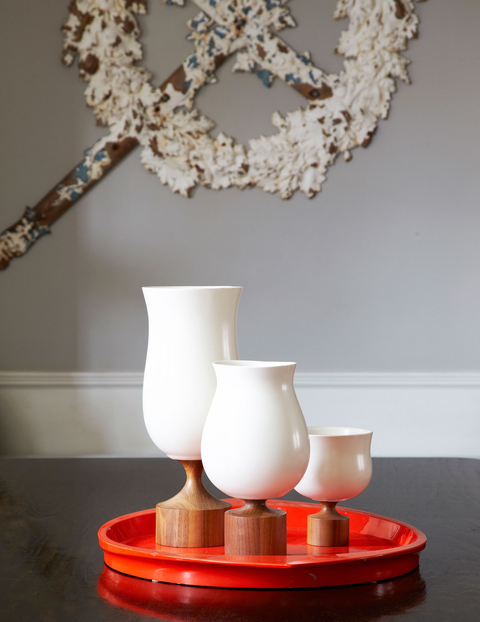 Three walnut-and-porcelain pieces by KleinReid.