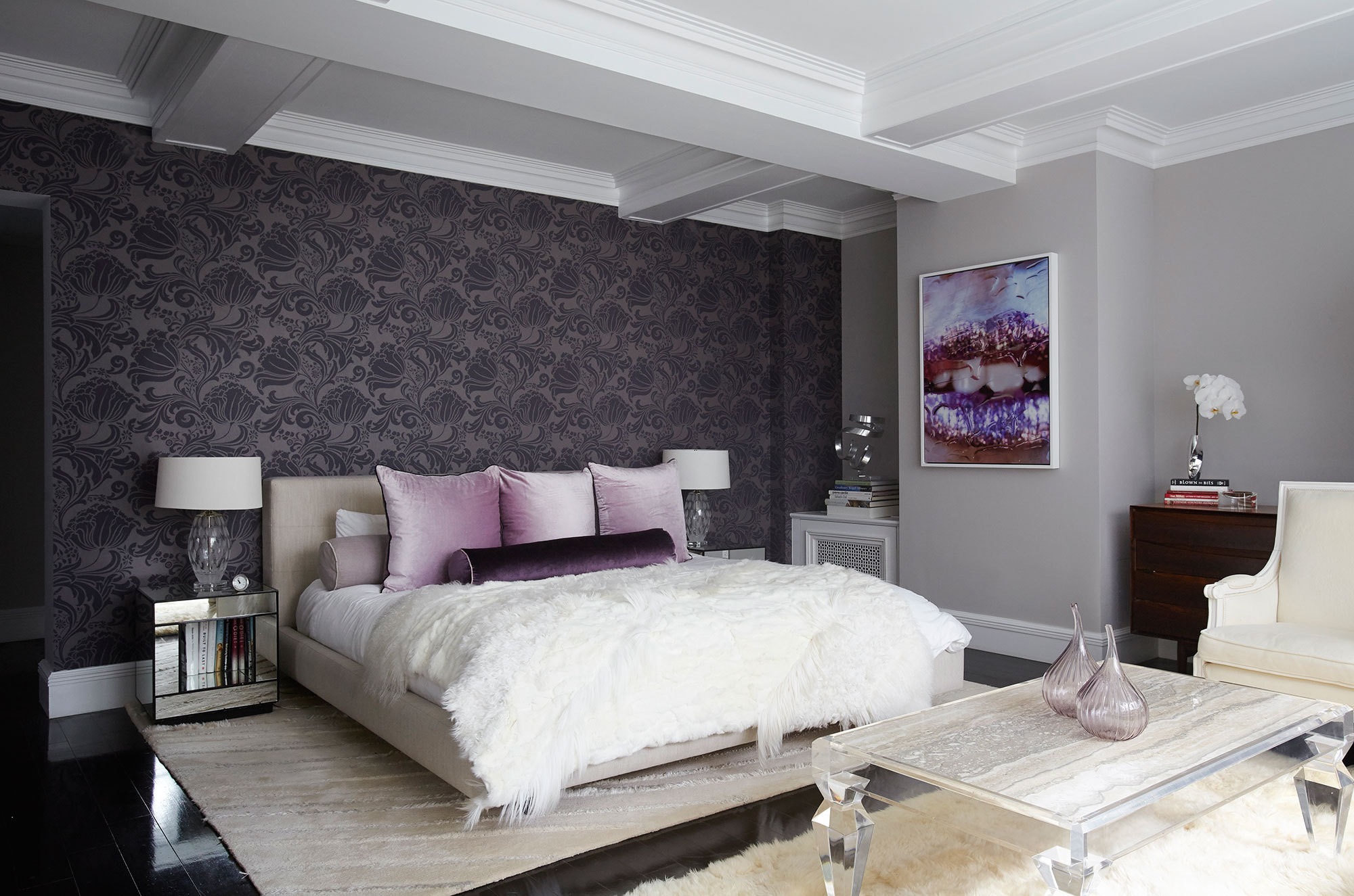 Soft textures in the master bedroom offer a lush respite from long days in the city.