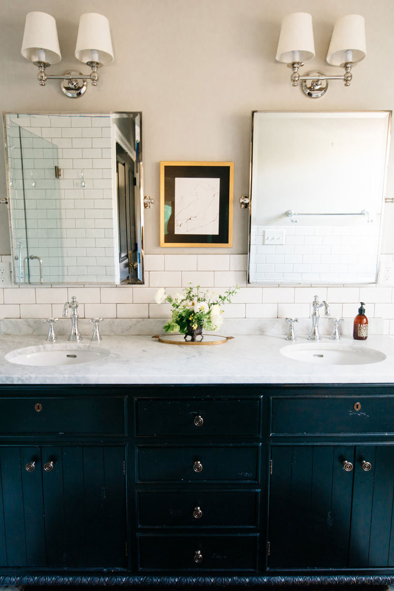 Mirrors, lighting, and cabinetry in the master bathroom was purchased at Restoration Hardware.