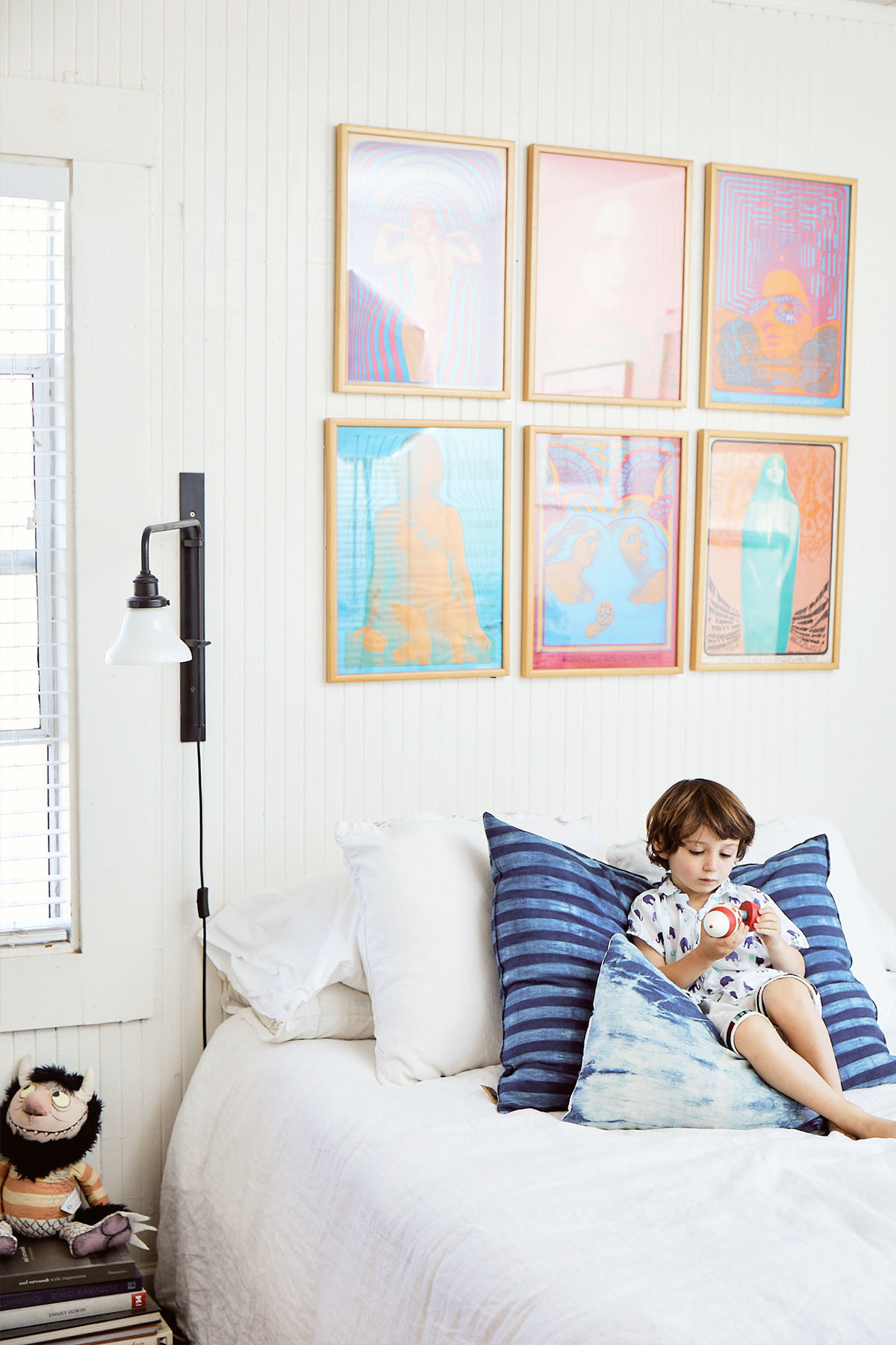 """""""Our bedroom is for snuggling, sleeping, and reading — it gets beautiful light throughout the day,"""" says Colla.IKEA Bed 