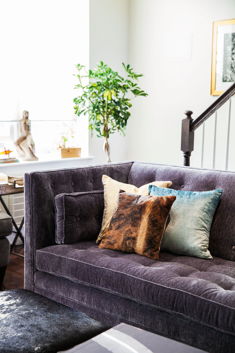 The sofa-and-ottoman combination from Arhaus provides maximum versatility for the space—and the surfaces are hardy enough to keep up with the living area's romper-room duality.