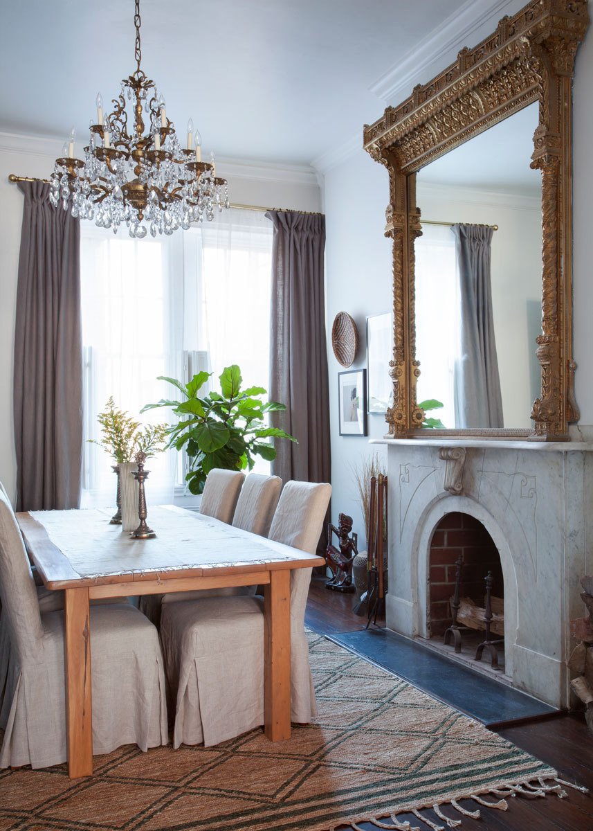 The designer used her own fabric for slipcovers in the dining room.