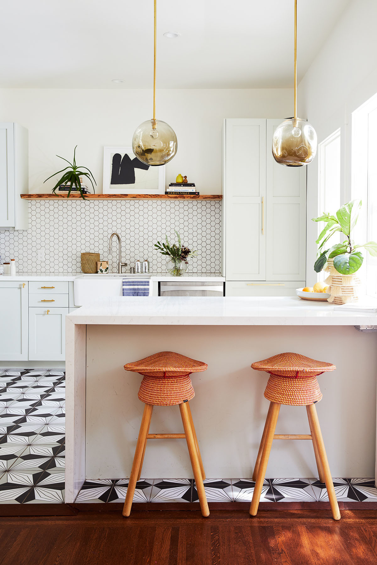 The couple's modern family-style kitchen.  | The Tile Shop Backsplash IKEA Cabinets | Farrow & Ball Cabinet Color | Semihandmade Fronts | Fireclay Tiles | Samsung Fridge | High Fashion Home Pendant Lights | Heurlier Cimolai Frederic Art | Umbra Counter Stools.