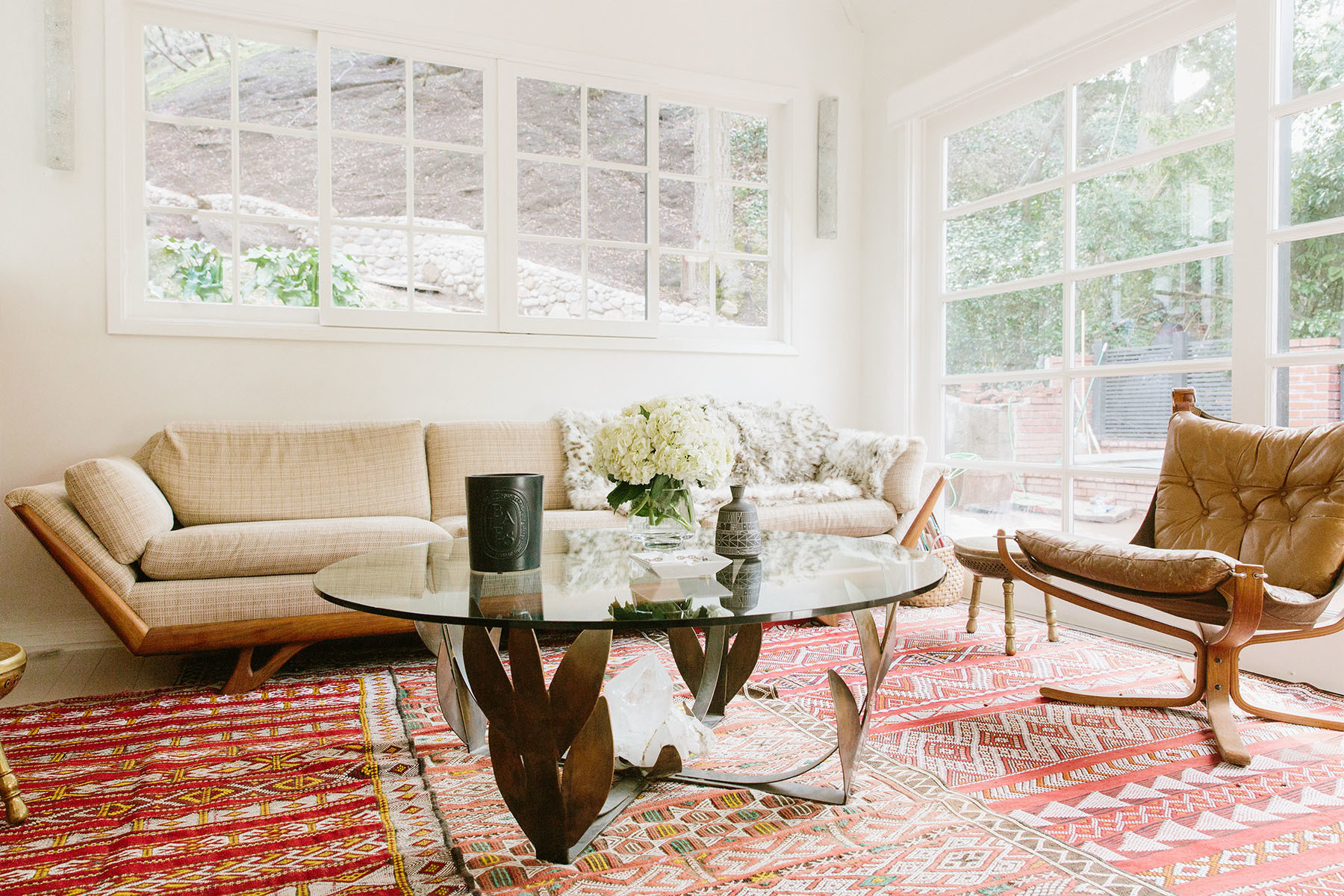 """Good rugs really tie a room together,"" says Sanders, of her expansive collection of Moroccan rugs, many of which sourced via a traveling friend. 1stdibs Vintage Furniture 