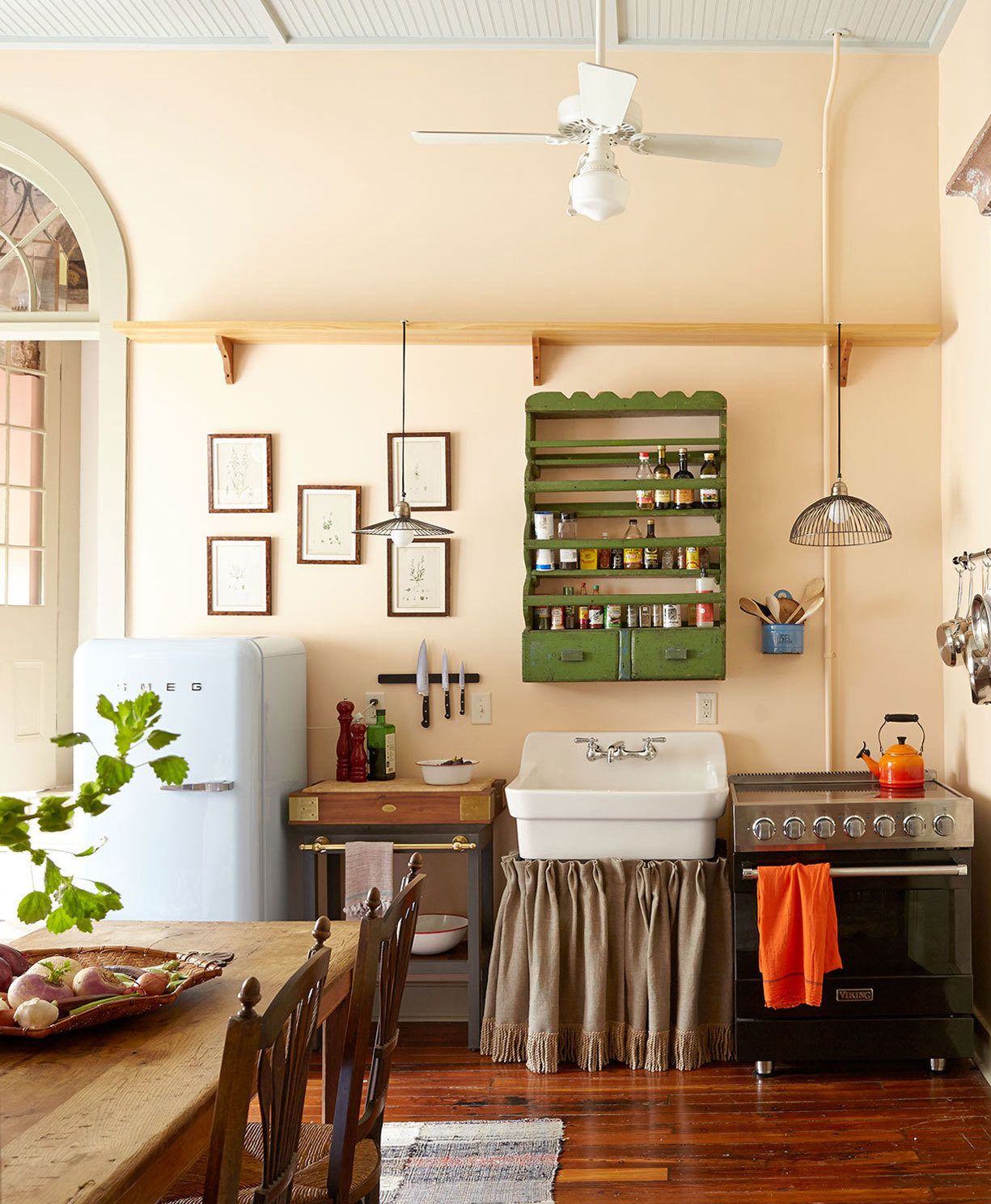 Standard contemporary kitchen cabinets were replaced with a spirited mix of vintage fittings.