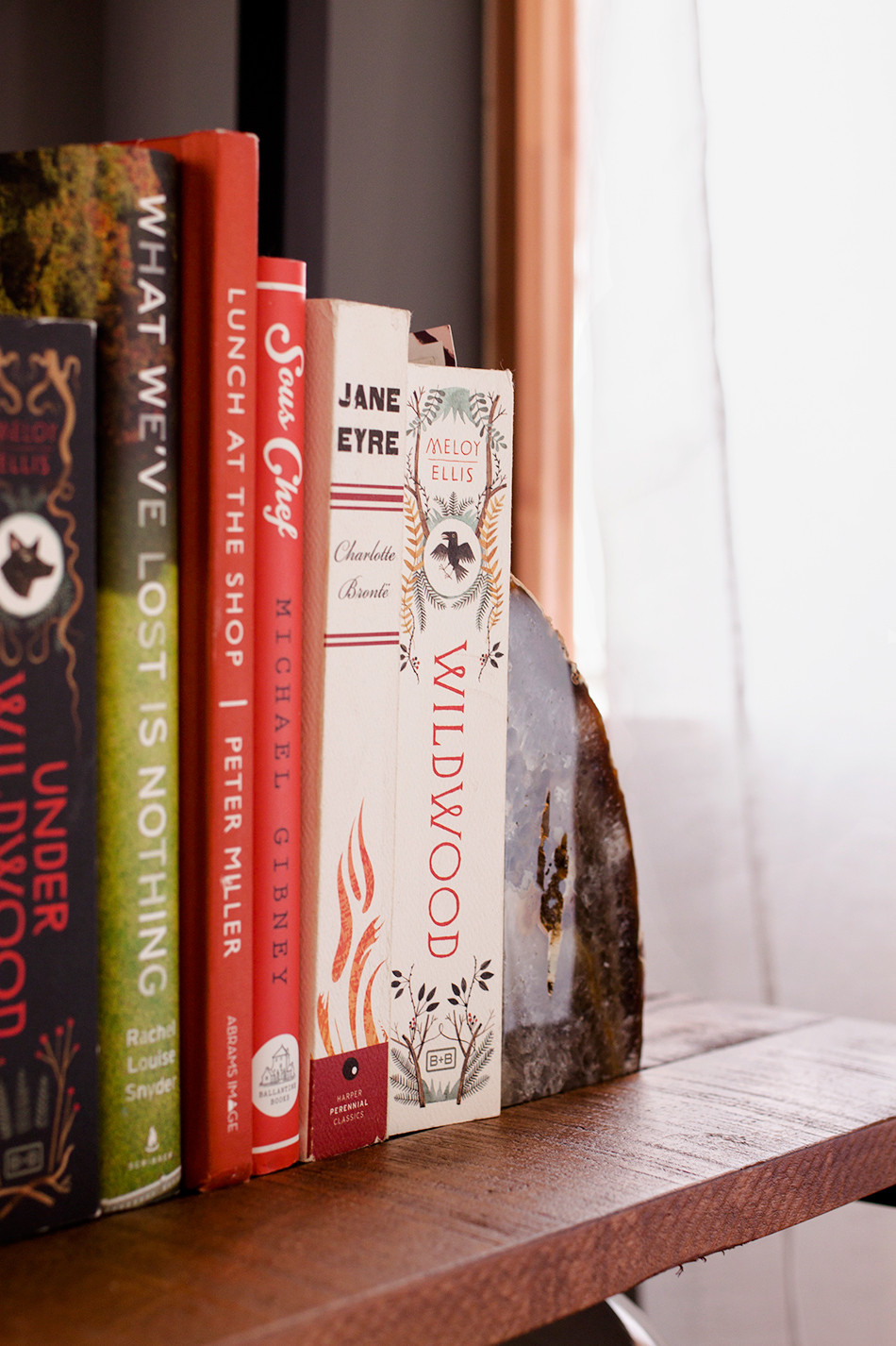 """<a  target=""""_blank"""" href=""""http://www.zgallerie.com/p-16014-agate-bookends.aspx"""">Agate Bookends</a>from Z Gallerie add gloss to the rustic bookshelf."""