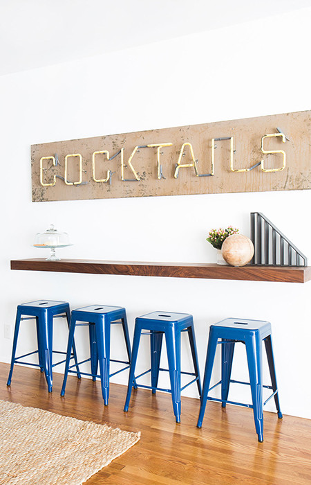 """""""The couple found the vintage 'cocktails' sign before they met me,"""" says Soria. """"It lights up and it makes them really happy, which to me, is the point of great design."""""""