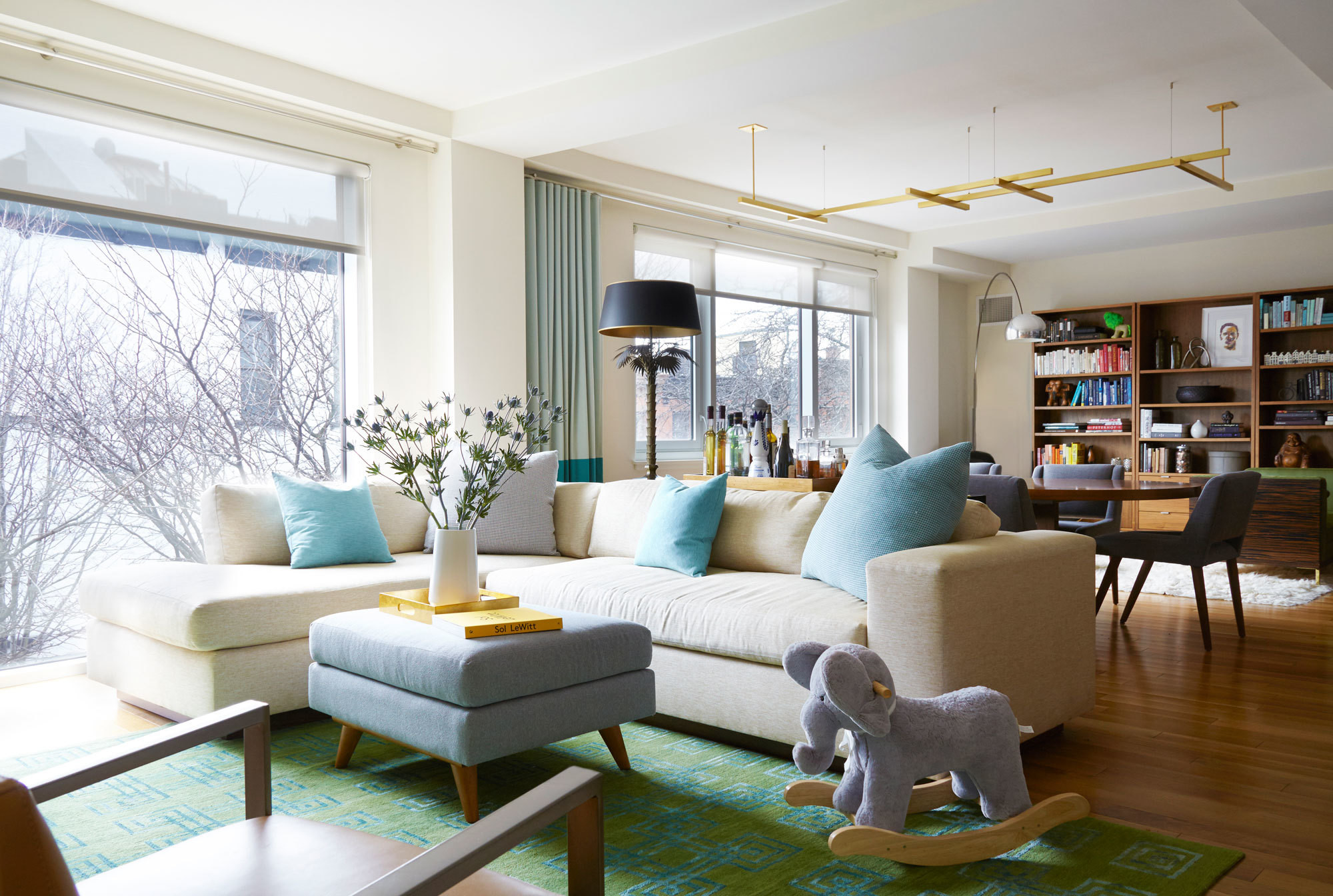 ID 810 Design Group expertly divides an extra-long living spaceand adds color and sophistication to a young family's bareBrooklyn home.