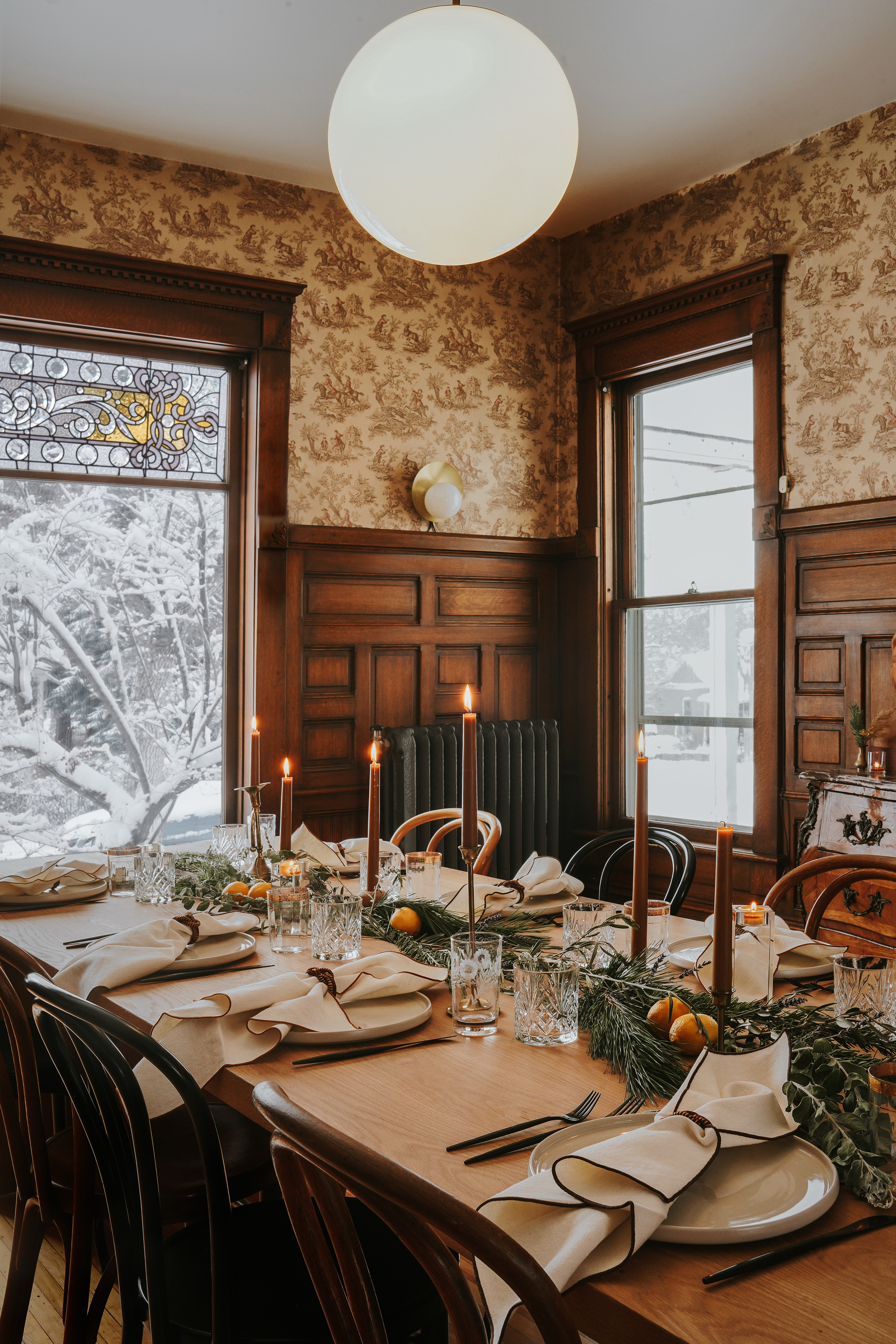 The rich history of this home is visibly present in the dining room. Green Seam Designs Custom Dining Table; Vintage Bentwood Chairs; Cedar & Moss Wall Sconce; Original Wallpaper; Afloral Candle Holders; The Floral Society Candles; West Elm Plates; Waterford Crystal Tumblers; CB2 Cutlery; Atelier Saucier for The Weavers Studio Napkins; Sequence Collection for The Weavers Studio Napkin Rings.