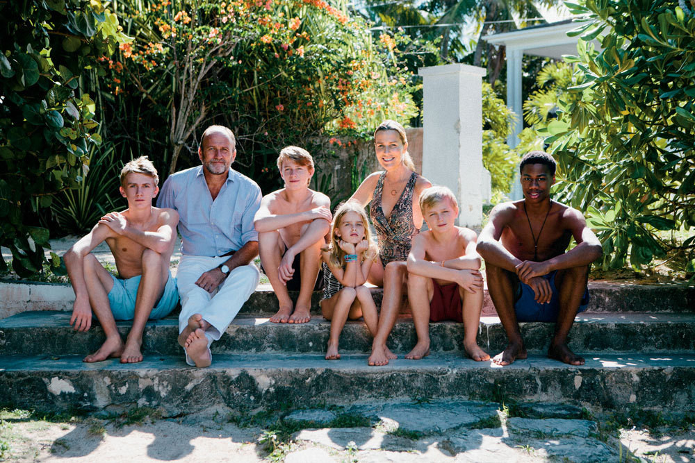 Hicks at home on Harbour Island with her partner, David Flint Wood, and their children (from far left): Felix, Amory, Domino, Conrad, and Wesley.