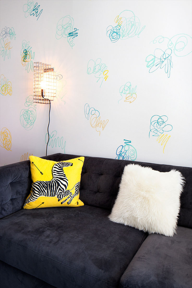 Oil stick scribbles created by Mui are a tongue-in-cheek wallpaper alternative for the playroom