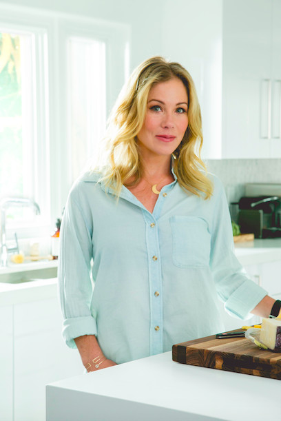 Actress Christina Applegate in her newly renovated kitchen, designed by Laurel & Wolf.
