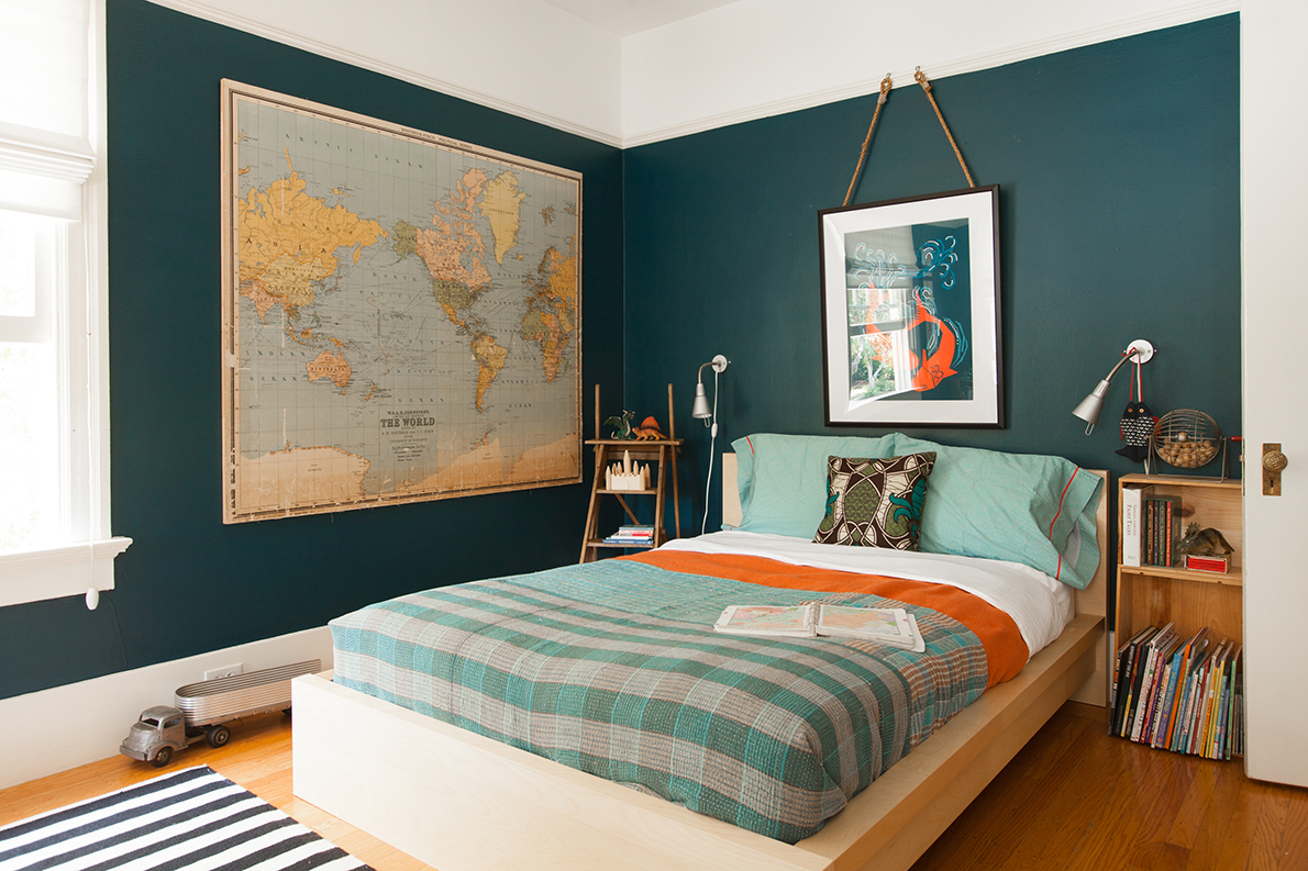 Clement's bedroom houses an Indian Kantha quilt and a vintage pre-war map of the world.