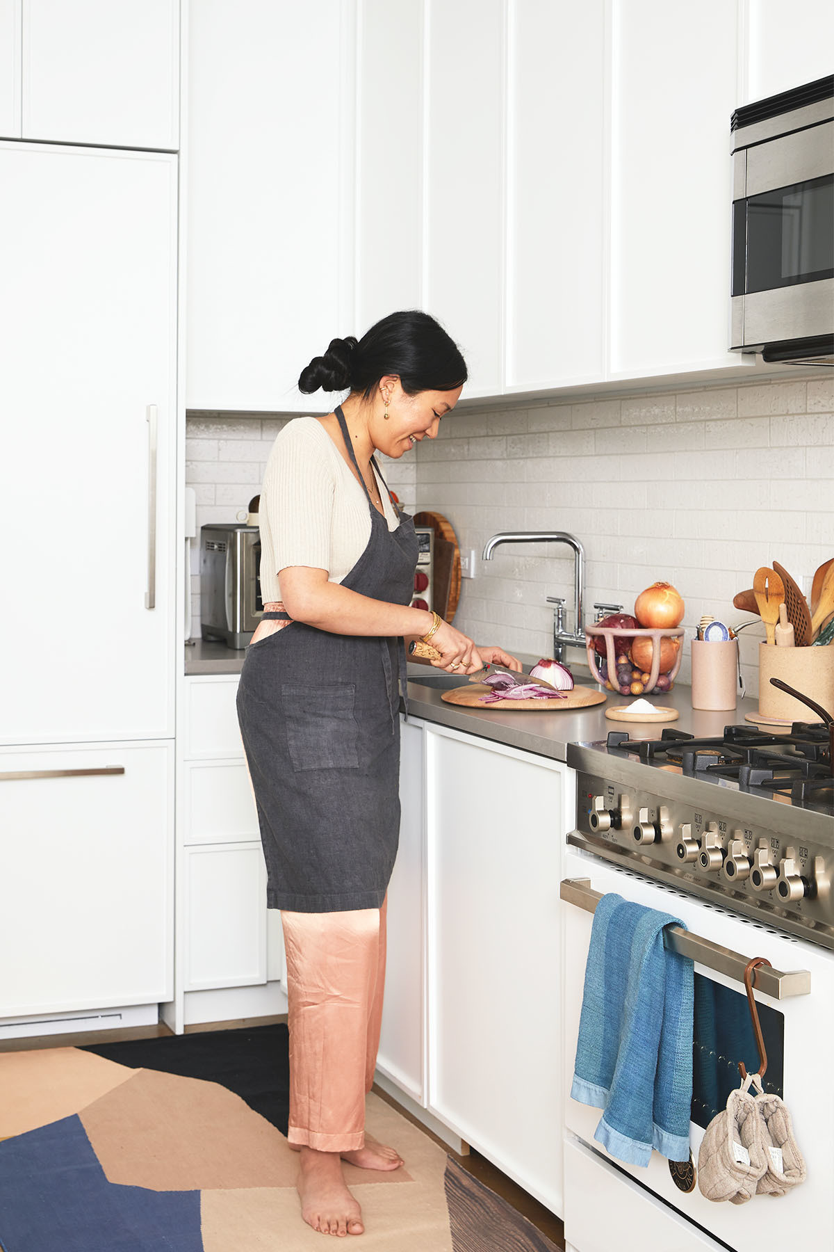 "Sin describes the couple&squot;s clean, contemporary kitchen as her ""happy place."" Kulfi Malai Area Rug 