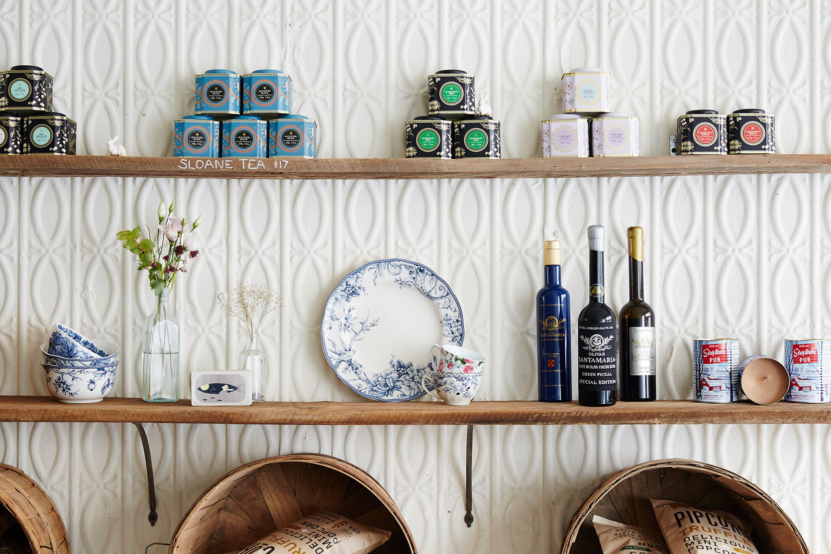 Salvaged materials and eye-catching patterns are used judiciously throughout Maman's welcoming interior.