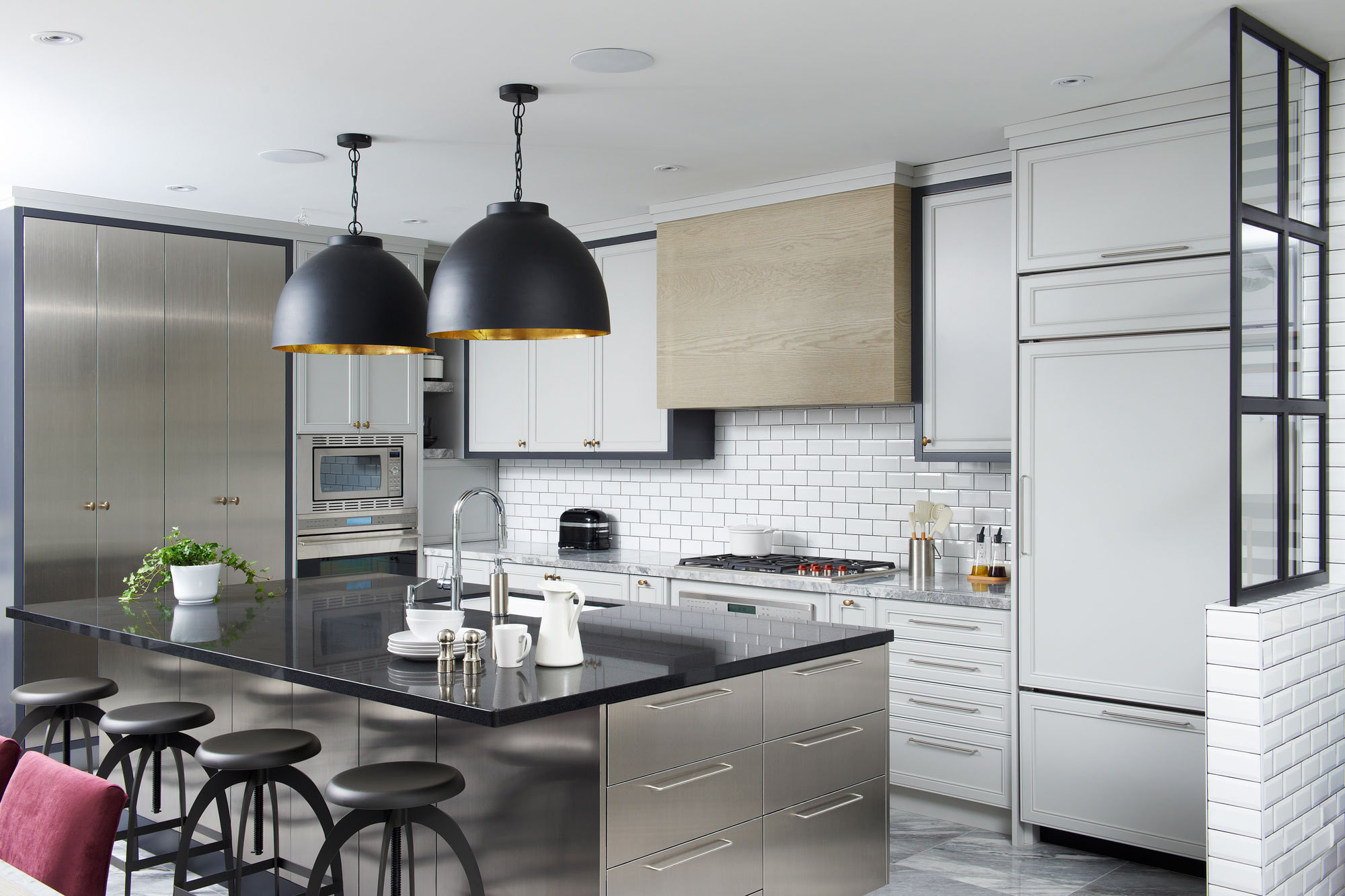 Designer Stacey Cohen installed functional stainless-steel cabinetry in the kitchen of a gut-renovated three-bedroom home in Toronto. Photography by Kevin Sparkman.