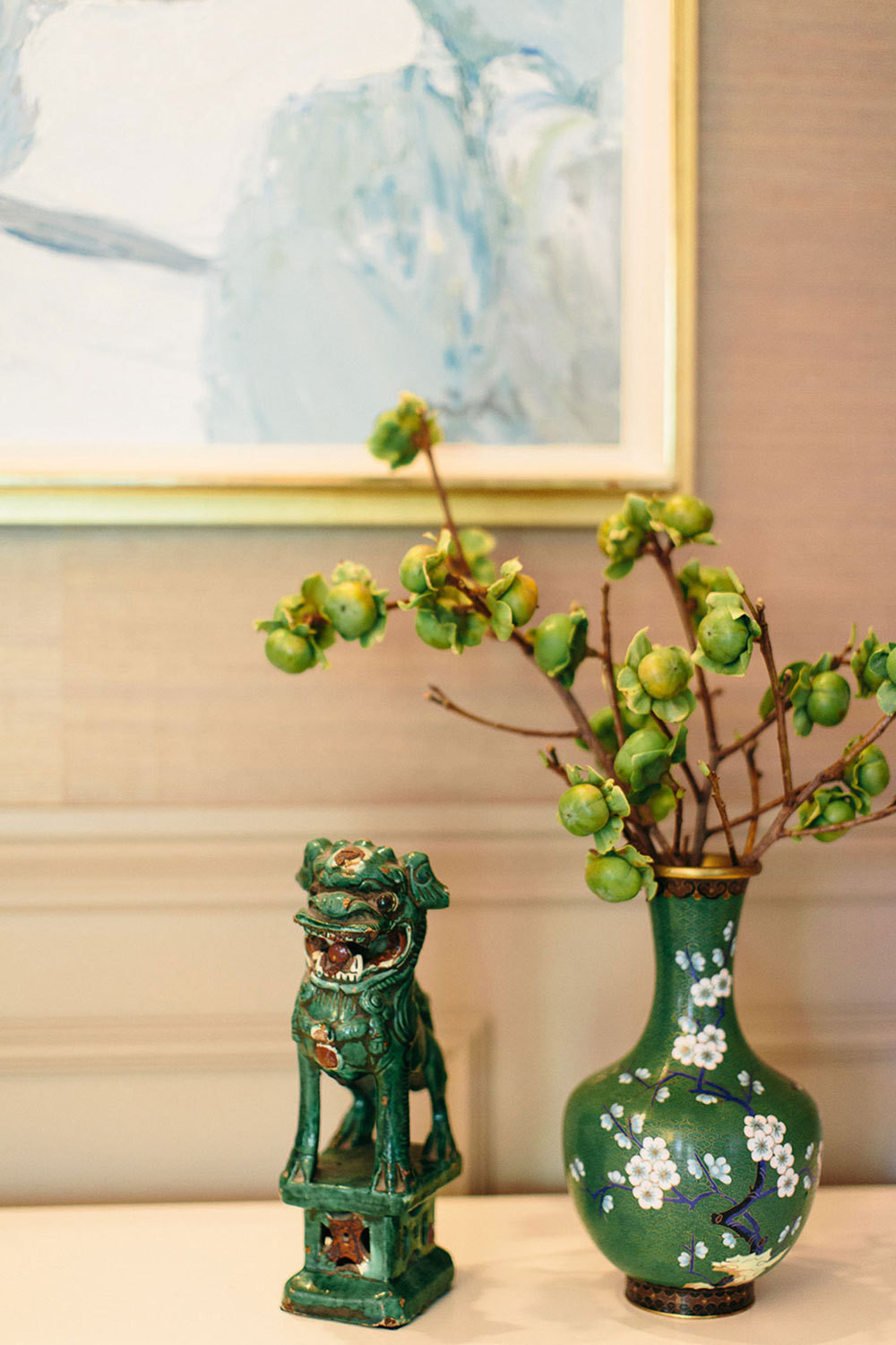 Antique figurines and Roger Mühl painting are safely out of little ones' reach in the dining room.