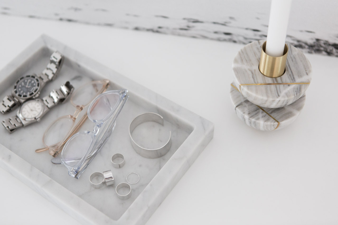 Babuskova keeps her accessories in order with a clean-lined marble tray.