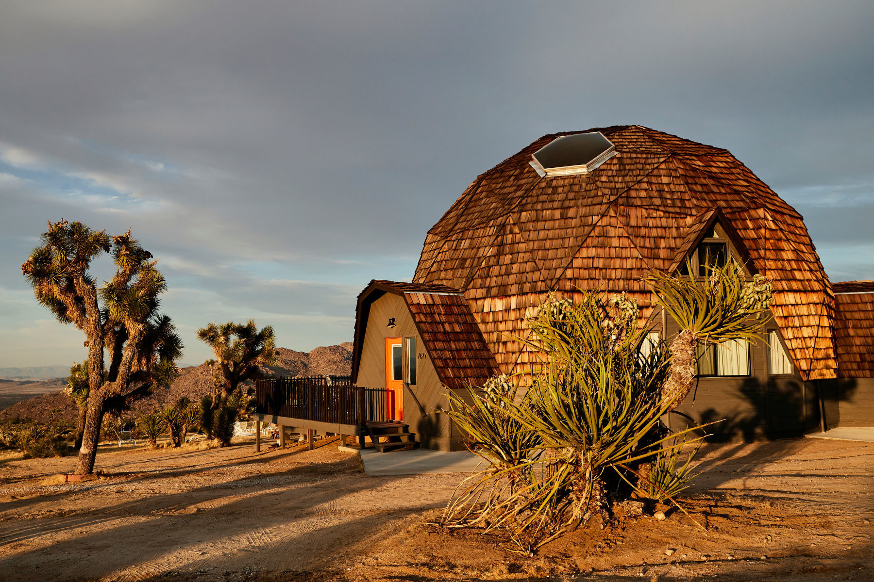 Corey Lynn Calter's dome house decorates the stark Joshua Tree landscape. Benjaminn Moore Paint.