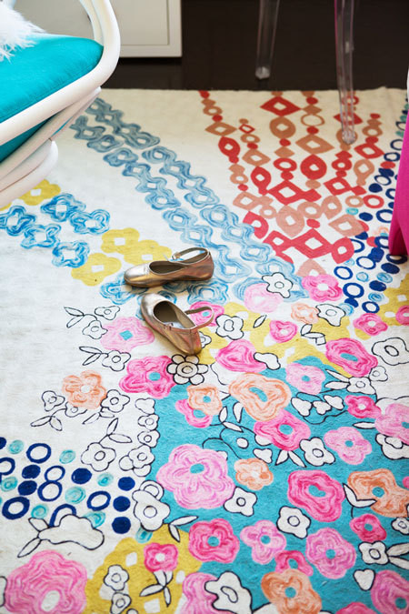 The Confetti Flora Rug by Anthropologie creates interest underfoot.