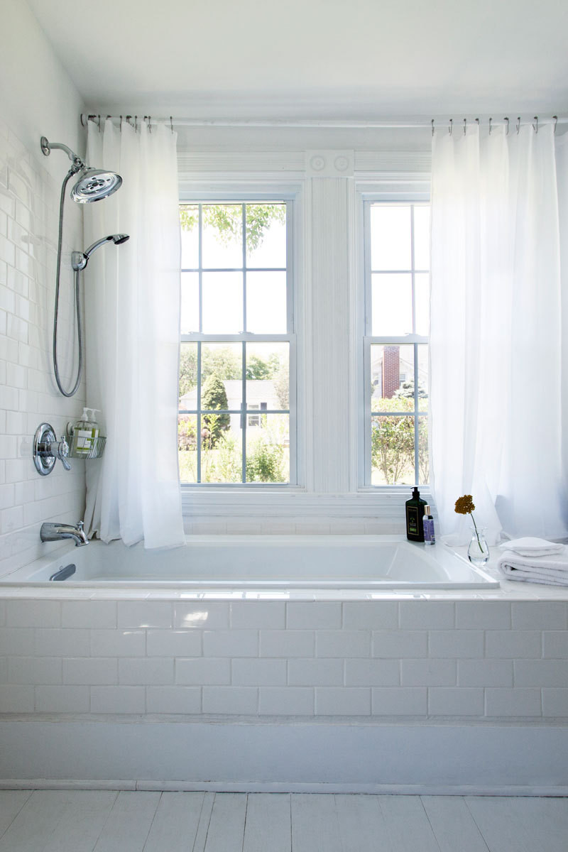 The guest bathroom features a tub with generous views.