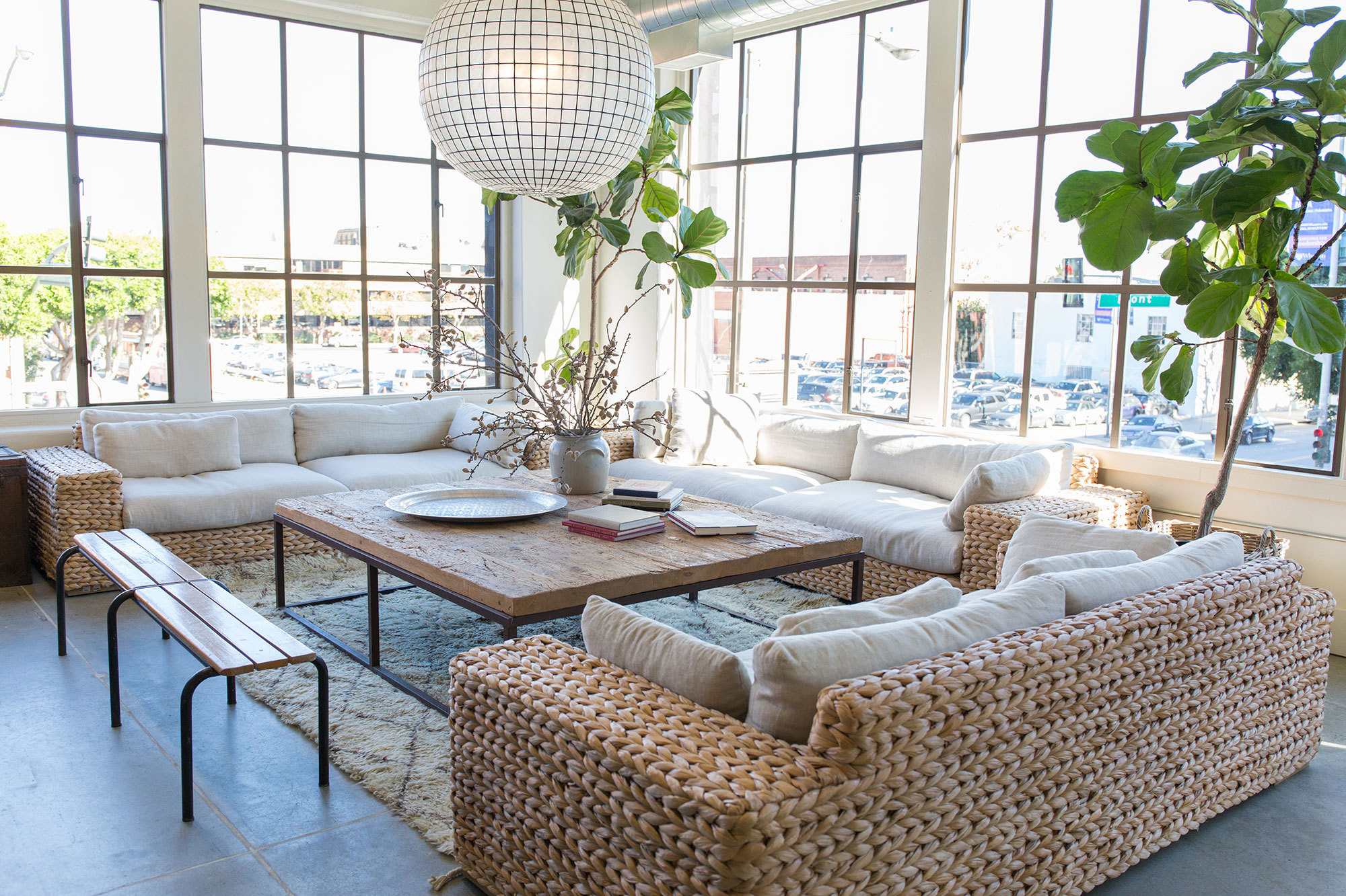 The Minted Headquarters aren't your ordinary offices. Employees enjoy communal spaces like this sunny sitting area outfitted with oversized wicker sofas.