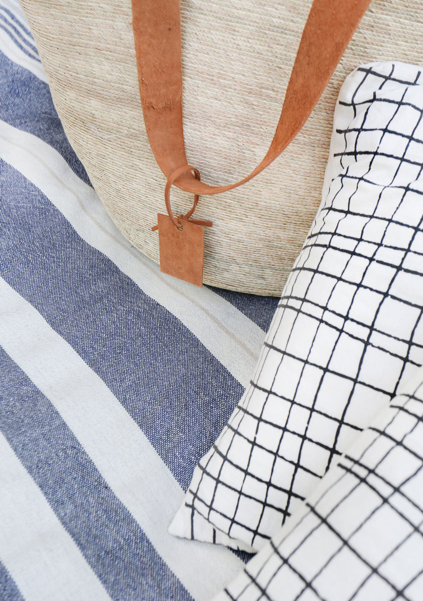 A blue-and-white blanket and market tote from The Citizenry are some of her picnic essentials.