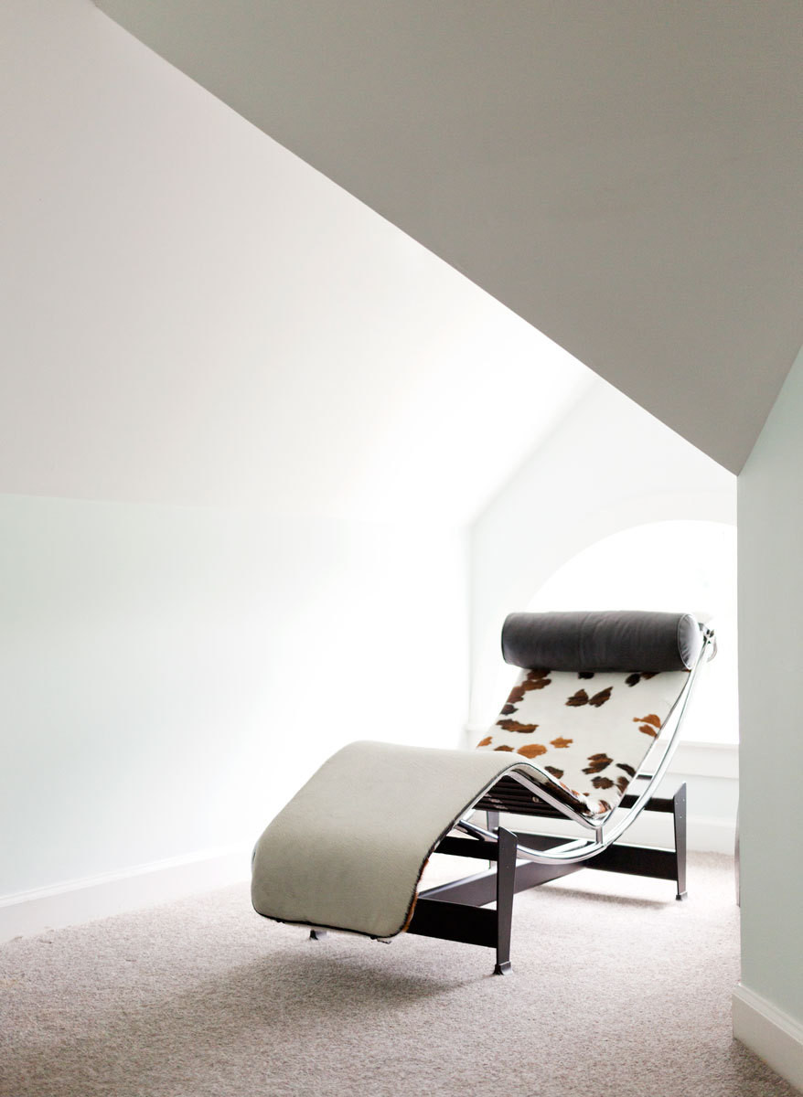 A Le Corbusier chaise placed beneath a skylight in the master bedroom is the perfect place to watch the trees.