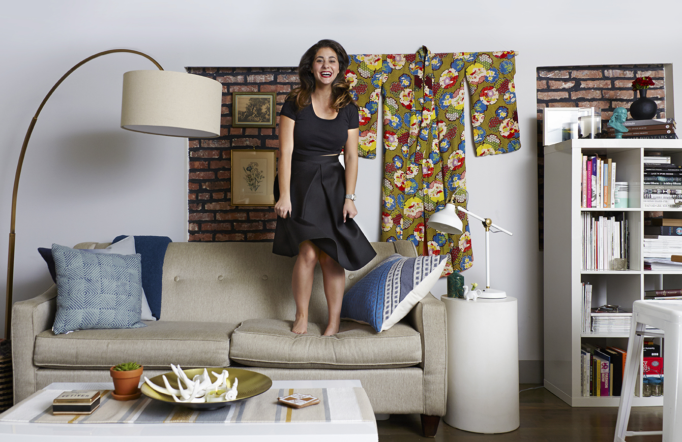 Garruppo's eclectic-modern living room features a floor lamp by West Elm and printed throw pillows from Alt for Living.