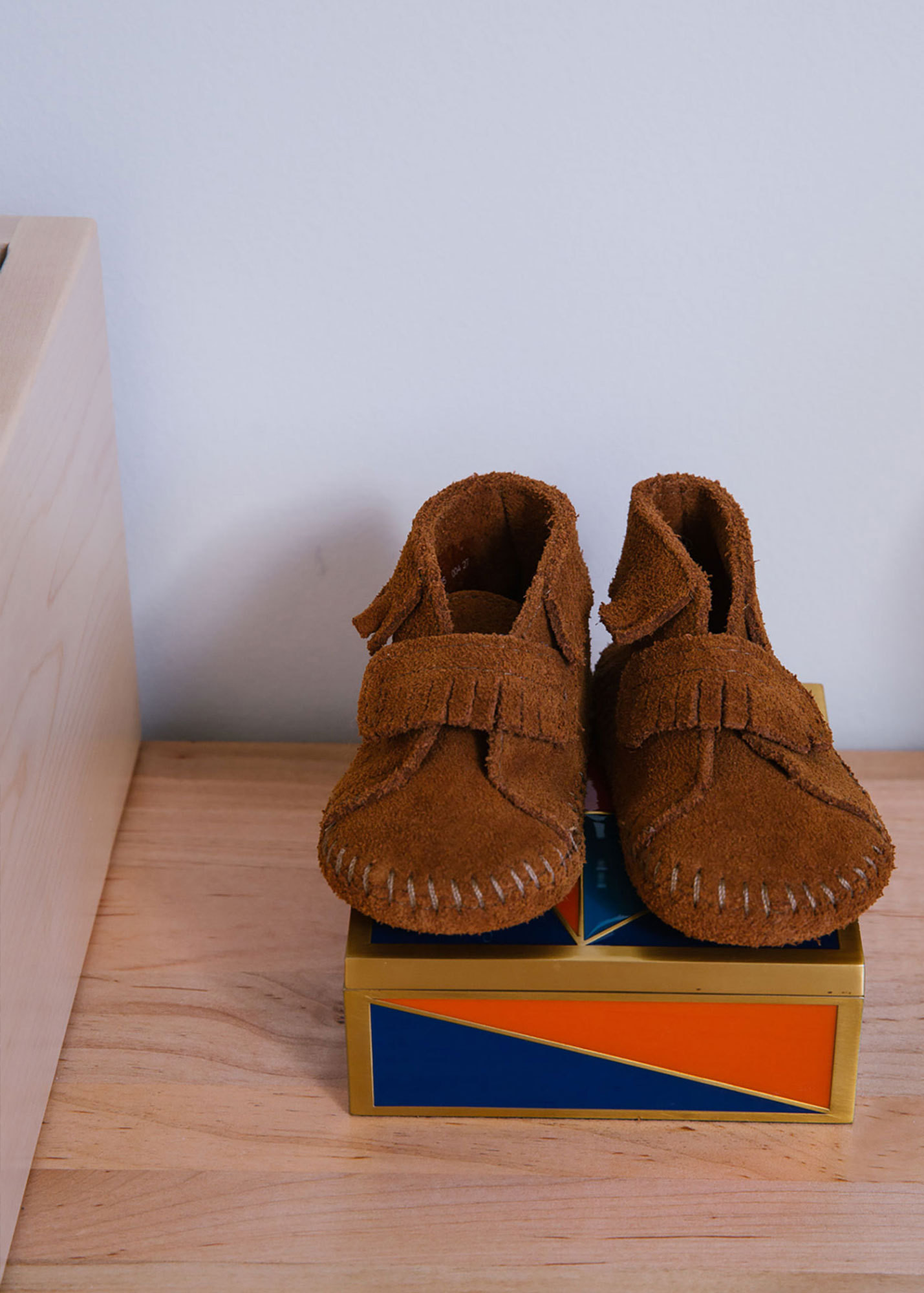 Suede booties await pint-size feet.