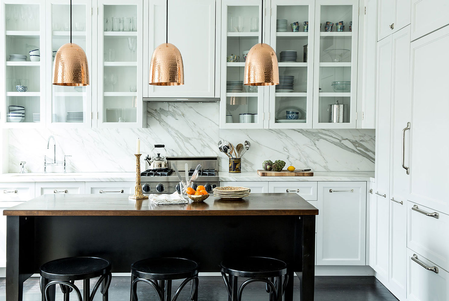 Marble and copper strike subtle yet luxe notes in the Winsteads' open kitchen.