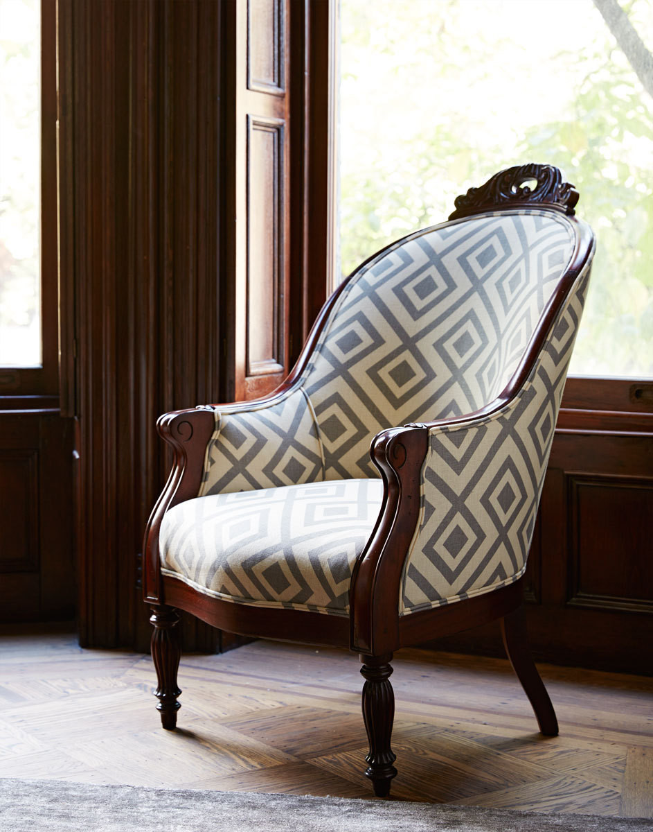 The owners' heirloom chair was recovered in a boldly geometric David Hicks fabric.